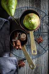 Ingredients for mulled wine on old wooden table