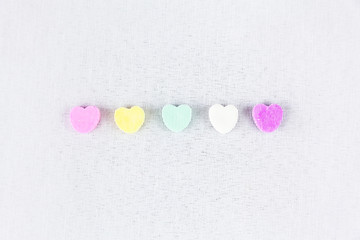 Conversation Hearts Line Up On A White Background