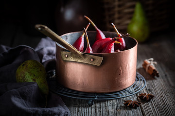 Sweet mulled wine with pears and anise star