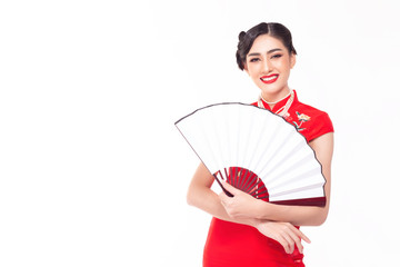 Charming beautiful Chinese woman wear chinese dress or cheongsam and pearl necklace with smiley face. Gorgeous woman hold Chinese fan that can put advertising on fan. Isolated on white, copy space