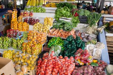 Market selling fruits and vegetables, bananas, papaya, watermelons, berries. South America, Ecuador.