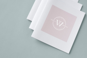 Three stacked white brochure mockups