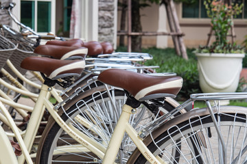 Close up saddle of vintage bicycle parking in the row. concept for ecology travel and transportation