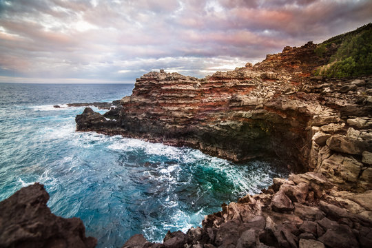 Ocean cliff bay with blue clear water at sunset time on Maui tropical island, Hawaii