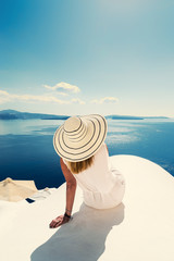 Luxury travel vacation woman looking at view on Santorini island