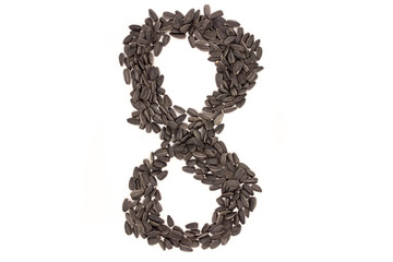 Numerals from black sunflower seeds isolated on white background.