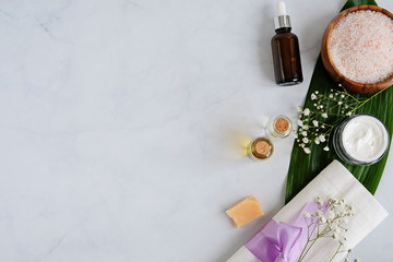 Spa natural skin care products background with space, cosmetic products - cream, oil and soap creative layout