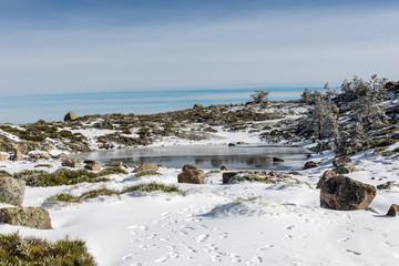 Glacial lagoon in the mountains of Madrid called Laguna Chica de de Peñalara