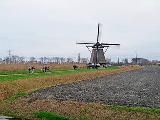 People walking during hiking event around the windmills of the molenviergang in Zevenhuizen the Netherlands