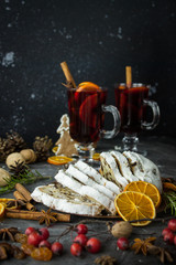 Traditional stollen and milled Hot wine cake and Christmas decorations