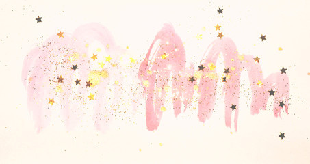 Golden glitter and glittering stars on abstract pink watercolor splashes in vintage nostalgic colors.