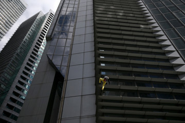 French climber Robert scales the 47-storey GT International Tower in Makati City