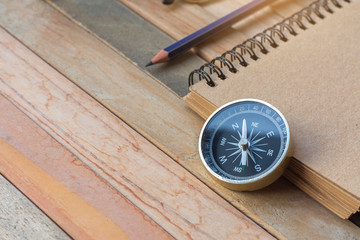 Compass, Notepad with pencil on wood board background.using wallpaper for education Wall mural