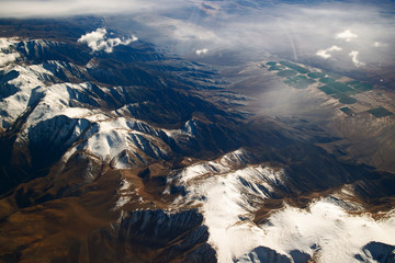 California mountains covered with Snow aerial View from airplane, California, USA