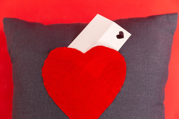 Handmade pillow with a picture of the heart with a card for text