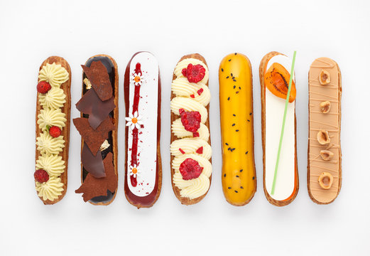 Group of french dessert Eclair on white background, top view
