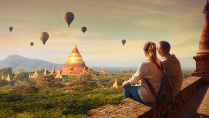 Wall Murals Deep brown Young couple in summer vacation travels around Myanmar.