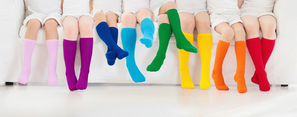 Kids with colorful socks. Children footwear. Wall mural