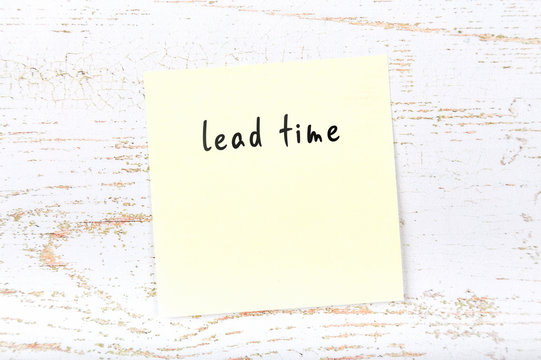 Yellow sticky note with handwritten text lead time