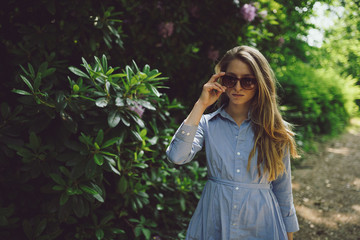 Beautilful young girl walking through a park