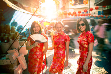 three asian woman wearing chinese tradition clothes toothy smiling face in yaowarat street china bangkok thailand