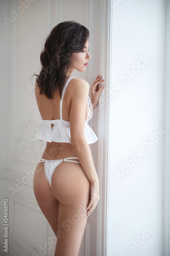 9b98aa88a07 Beautiful sexy girl in underwear view from the back.