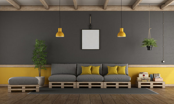 Gray and yellow living room with pallet sofa