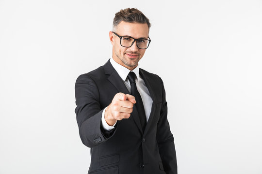 Handsome business man isolated over white wall background posing pointing.