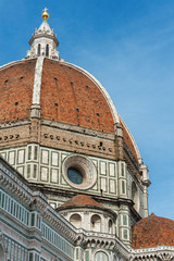 Fototapete - The dome and cross of the Basilica di Santa Maria del Fiore (Basilica of Saint Mary of the Flower). View from Giotto's Campanile. Florence, Tuscany, Italy.