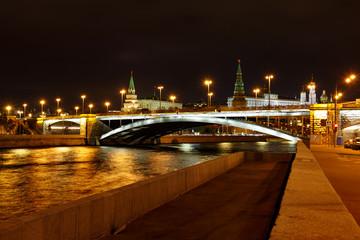 View of Sofiyskaya Embankment of Moskva river and Bolshoy Kamenny Bridge with night illumination. City landscape