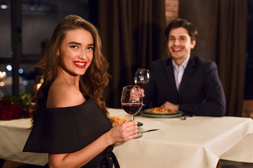 Romantic couple having dating in restaurant.