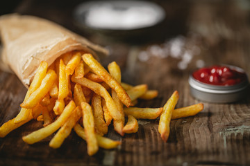French fries in a basket with ketchup