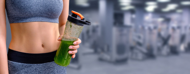 Young girl drinking smoothie after workout. Fitness and healthy lifestyle concept.