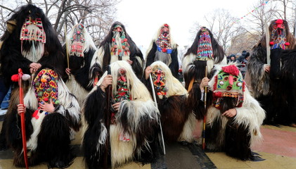 Pernik, Bulgaria - January 27, 2019 - Masquerade festival Surva in Pernik, Bulgaria. People with mask called Kukeri dance and perform to scare the evil spirits.