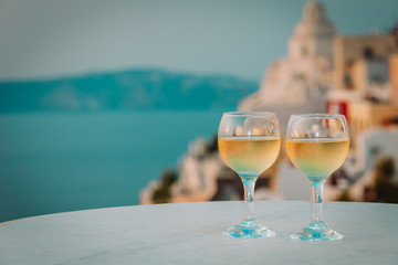 romantic vacation in Greece -two wine glasses in Santorini