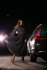 night photo of young girl with car