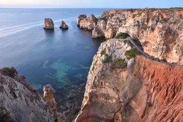 Ponta da Piedade, sandstone cliffs in morning light. Atlantic coast near Lagos Algarve region southern Portugal Europe.