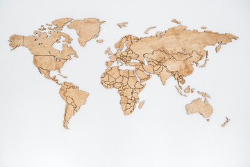 Photo sur Aluminium Amérique du Sud Wooden world map on a white wall. Geography concept. Background for travel. Logistics and transportation, worldwide business. All continent. Europe, America, Australia and Asia.