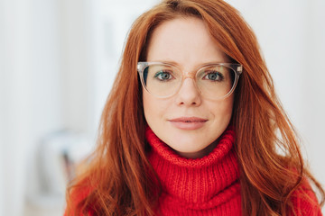 Serious young woman wearing spectacles