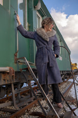 young woman in train station at sunny winter day