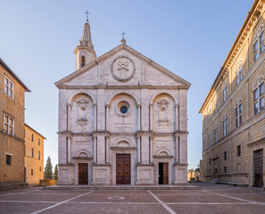 The beautiful facade of the Cathedral of the Assumption, the Duomo of Pienza, without people, Siena, Tuscany, Italy