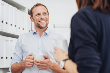 Man chatting with woman during coffee break