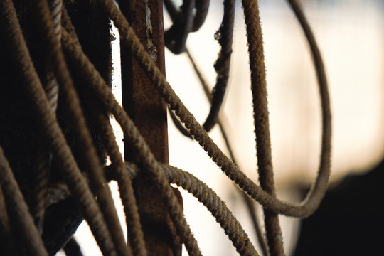 Western roping industry shown with rope close up in rustic country barn.