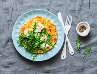 Summer squash frittata with goat cheese and arugula - delicious healthy diet food, breakfast, snack on a gray background, top view