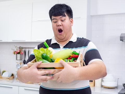 Fat Asian man choose healthy food for Diet.