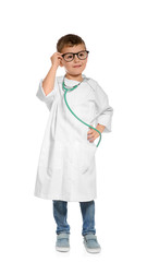 Cute little child in doctor coat with stethoscope on white background