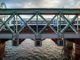 London train over bridge on water