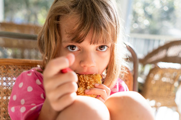 Close-up of girl eating a pancake