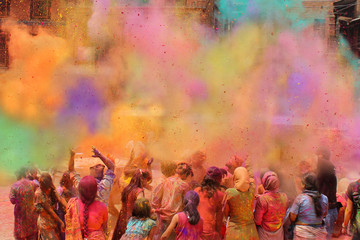 People celebrating the Holi festival of colors in India or Nepal Fotomurales