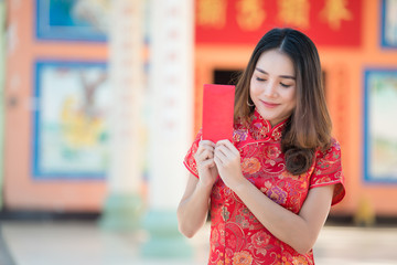 Portrait of beautiful asian woman in Cheongsam dress,Thailand people,Happy Chinese new year concept